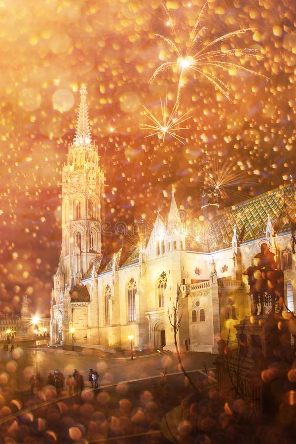 celebrating New Year in the city - Matthias church with firework, Budapest, Hungary royalty free stock photo