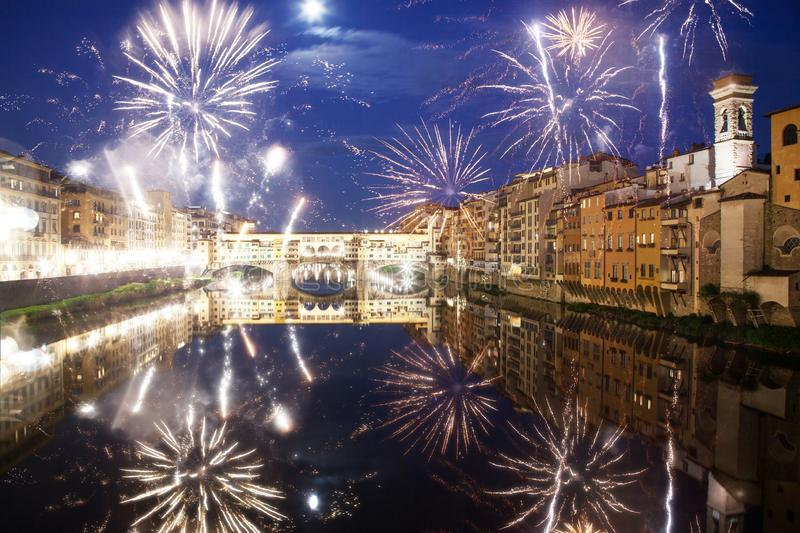 celebrating New year& x27;s eve in Florence, Italy - explosive fireworks around ponte vecchio on river arno royalty free stock photography