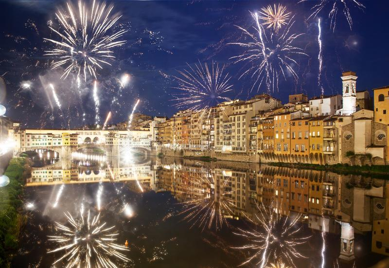 celebrating New year& x27;s eve in Florence, Italy - explosive fireworks around ponte vecchio on river arno stock photo