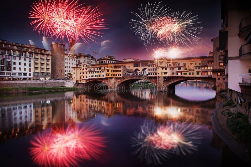 celebrating New year& x27;s eve in Florence, Italy - explosive fireworks around ponte vecchio on river arno stock photos