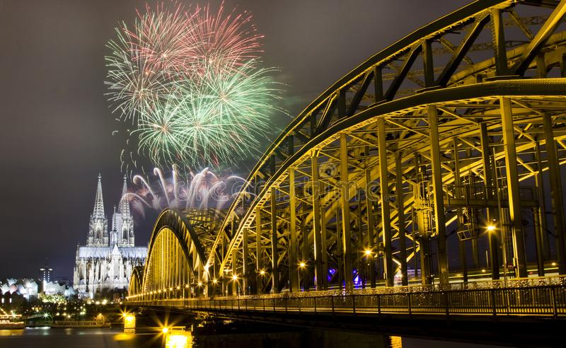 celebrating new year& x27;s eve in n Koln, Germany - fireworks around the Cologne cathedral stock images