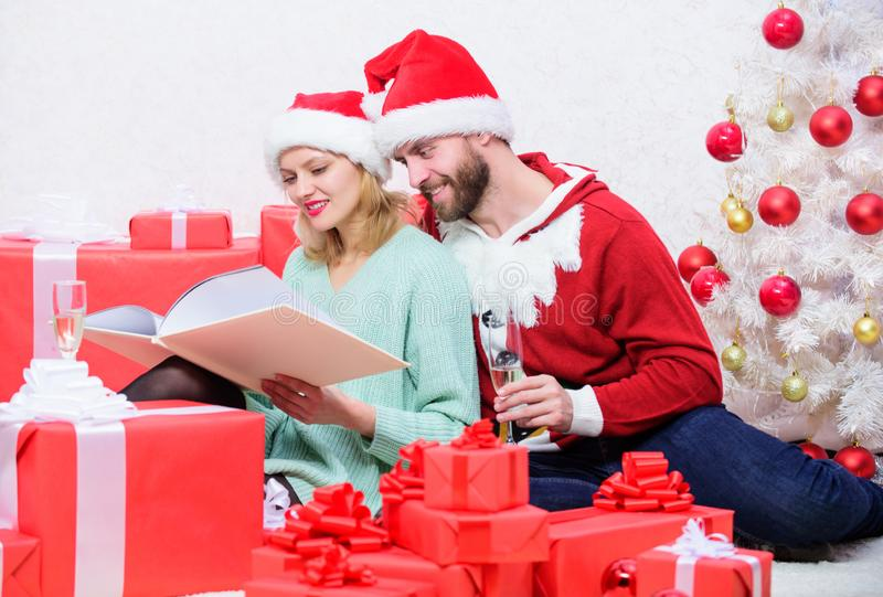 Celebrating new year together. Couple in love enjoy christmas. Family tradition. Family cuddle drink champagne near stock photos