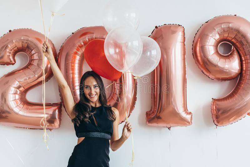Celebrating. New Year 2019. Woman with balloons having fun. royalty free stock images