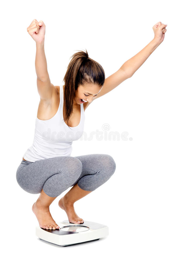 Celebrating scale woman stock photography