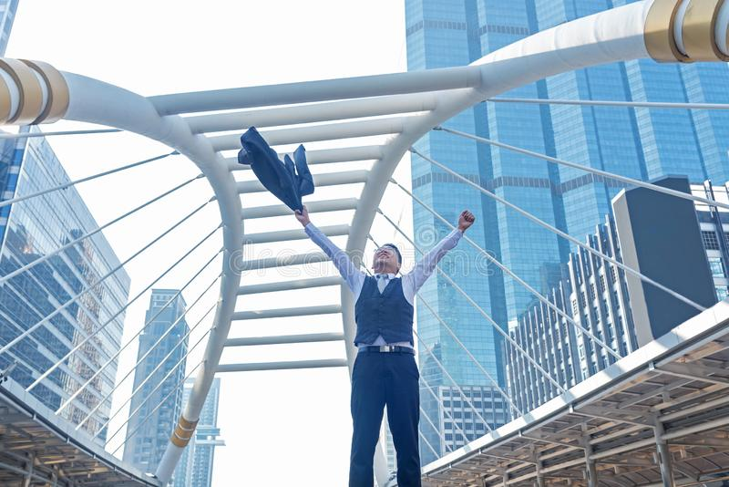 Celebrating success. Businessman keeping arms raised stock photography