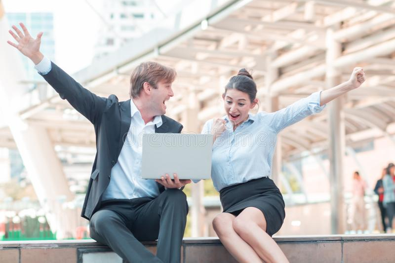 Celebrating success.Excited cheerful young business couple keeping arms raised and expressing positivity as they know the succes royalty free stock images