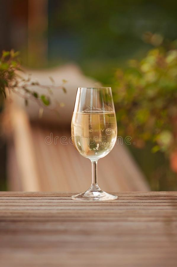Celebrating success and having a glass of wine at the terrace during a warm Summer evening while jazz is played on the background. royalty free stock image