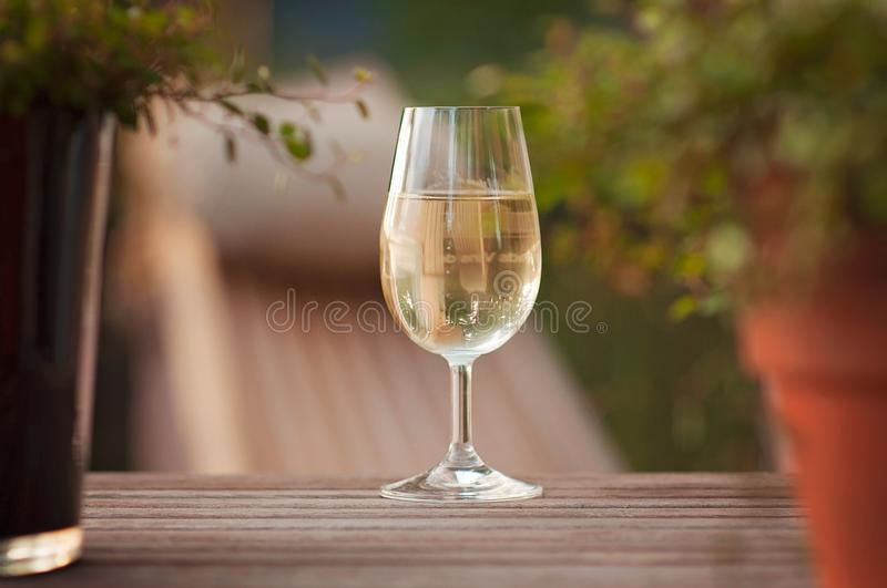Celebrating success and having a glass of wine at the terrace during a warm Summer evening while jazz is played on the background stock image