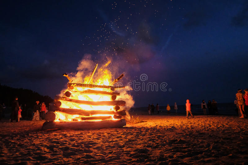 Celebrating the summer solstice. A large fire at the celebration of the summer solstice on the shore of the Gulf of Riga. Latvia stock images