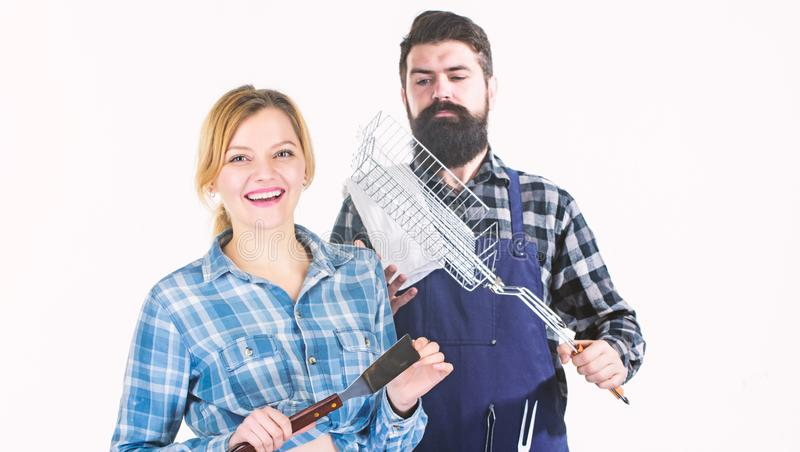 Celebrating their friendship. Tools for roasting meat. Man bearded hipster and girl. Preparation. Family weekend. Couple. Celebrating their friendship. Tools for royalty free stock photos