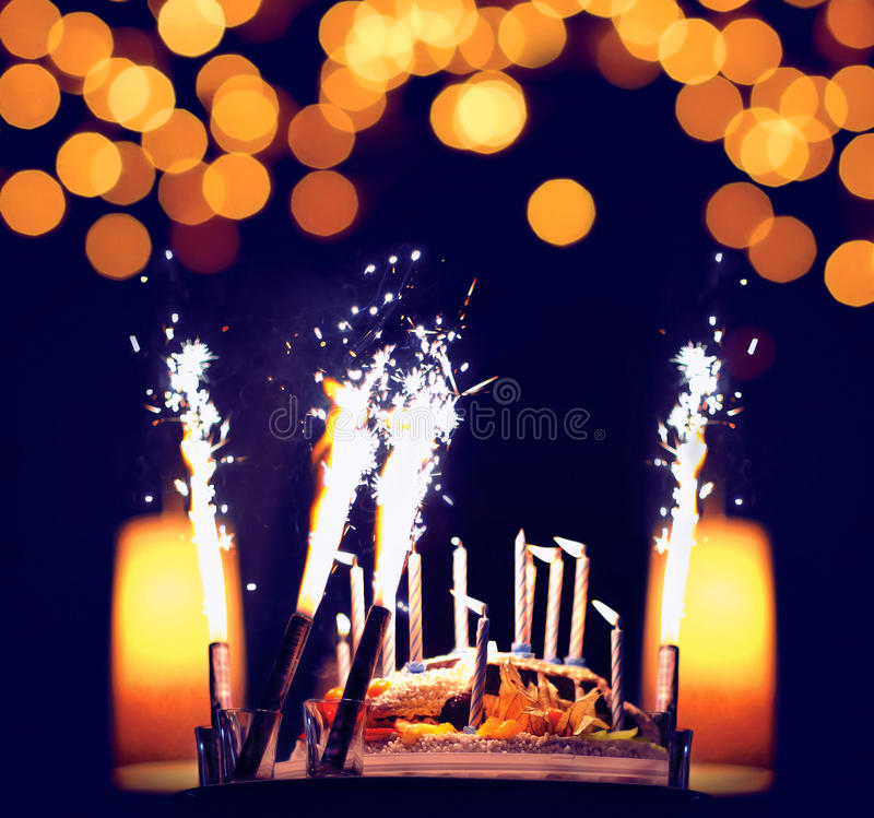 Celebration, birthday cake with candles. Bright lights bokeh royalty free stock image