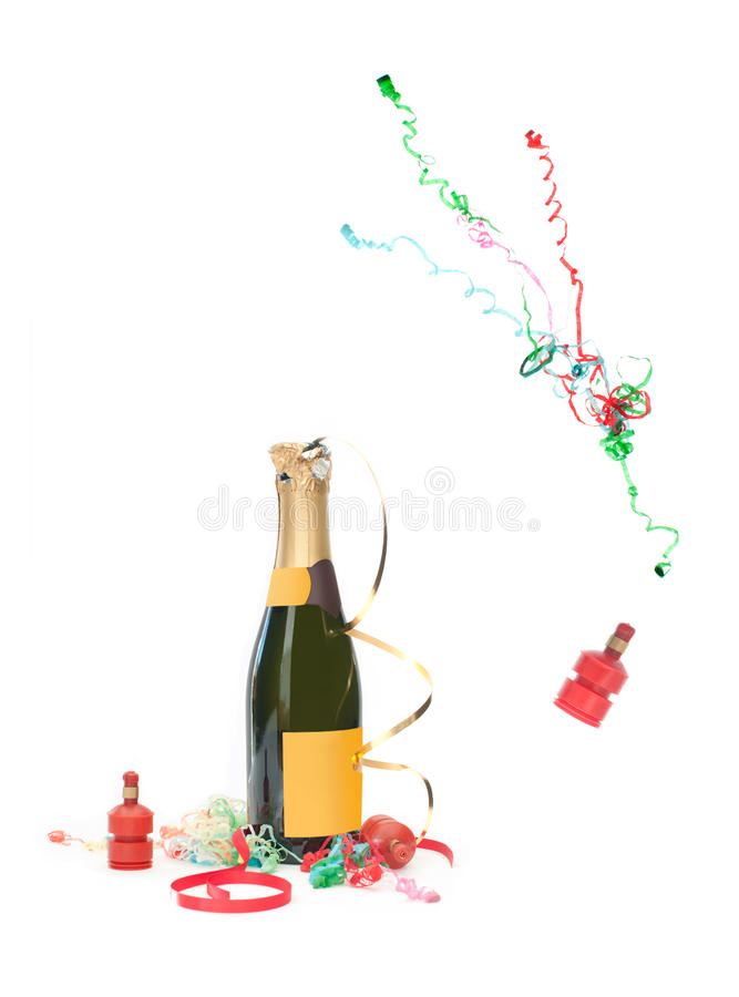 Celebration champagne. Champagne bottle and party streamer popping royalty free stock photo