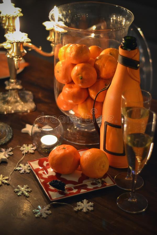 Celebration christmas still life with champagne, mandarines and caviar royalty free stock photography