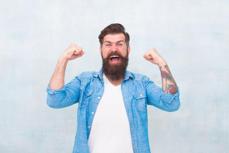 Celebration concept. Bearded man trendy hipster style. Cheerful mood. Happiness and joy. Hipster with beard and mustache royalty free stock photography
