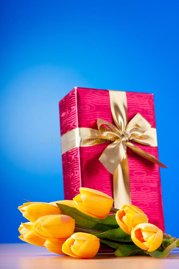 Celebration Concept - Gift Box And Tulips Royalty Free Stock Photos