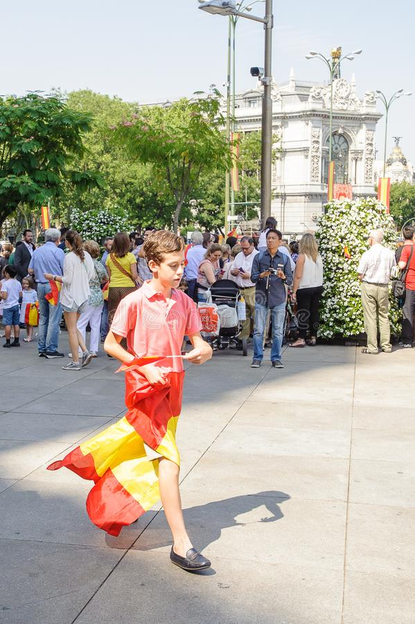 Celebration of the coronation of the New King of Spain Felipe IV. MADRID, SPAIN - JUN 19, 2014: Unidentified Spanish boy with the Spanish national flag in the stock photo