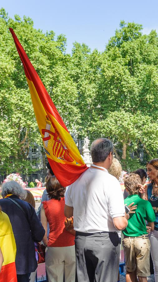 Celebration of the coronation of the New King of Spain Felipe IV. MADRID, SPAIN - JUN 19, 2014: Unidentified Spanish man waves the Spanish national flag in the stock image