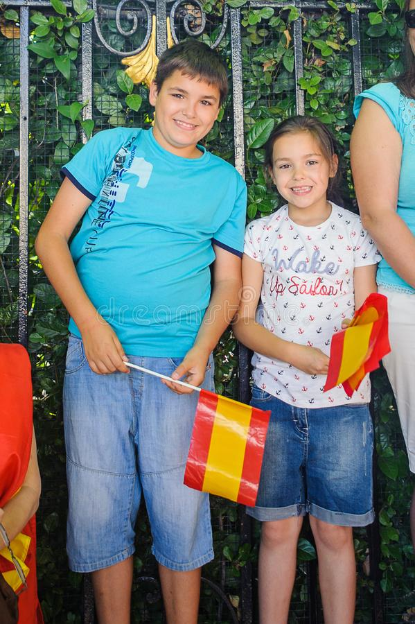 Celebration of the coronation of the New King of Spain Felipe IV. MADRID, SPAIN - JUN 19, 2014: Unidentified Spanish children Spanish national flags in the royalty free stock photo