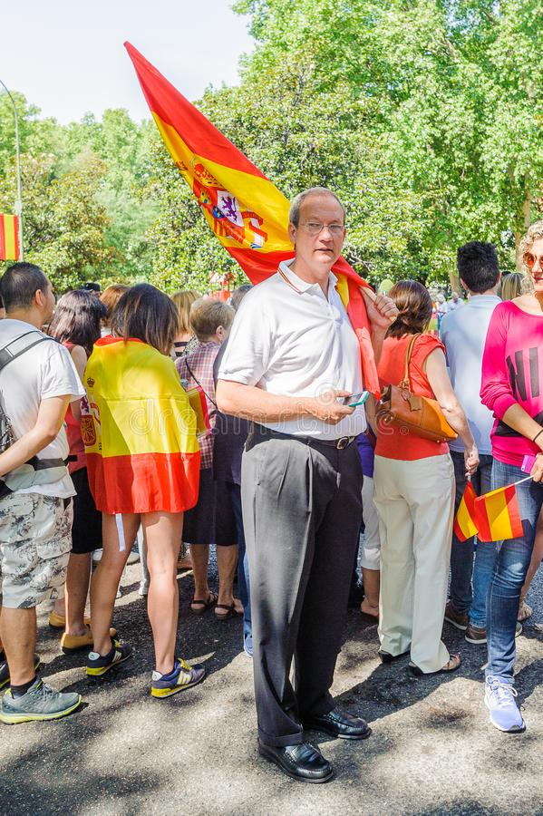 Celebration of the coronation of the New King of Spain Felipe IV. MADRID, SPAIN - JUN 19, 2014: Unidentified Spanish man waves the Spanish national flag in the royalty free stock image