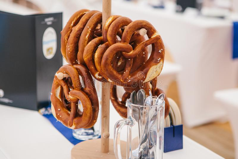 Celebration of the famous German beer festival Oktoberfest. Traditional pretzels called Brezel hang on the stand on the stock image
