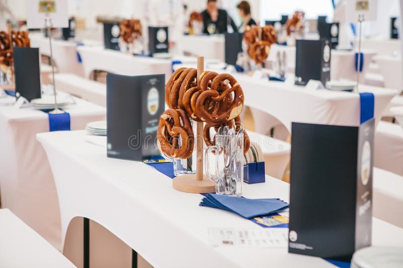 Celebration of the famous German beer festival Oktoberfest. Traditional pretzels called Brezel hang on the stand on the stock photo