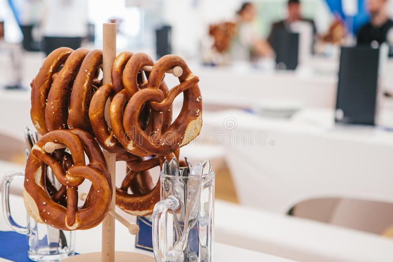 Celebration of the famous German beer festival Oktoberfest. Traditional pretzels called Brezel hang on the stand on the royalty free stock photo