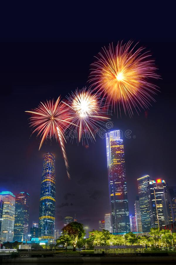 Celebration firework in twilight night cityscape of guangzhou urban skyscrapers at storm with lightning  bolts in night purple. Blue sky, Guangzhou, China royalty free stock photos