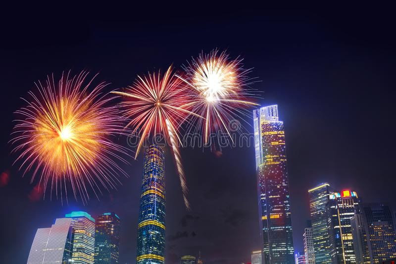 Celebration firework in twilight night cityscape of guangzhou urban skyscrapers at storm with lightning  bolts in night purple. Blue sky, Guangzhou, China stock photography