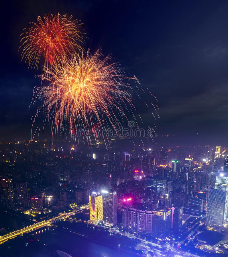 Celebration fireworks china nation day celebrate night in Guangzhou night cityscape with modern building of financial district and royalty free stock photos