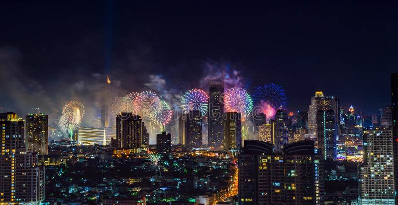 Celebration fireworks in the city at night time. Bangkok City. Thailand royalty free stock photo