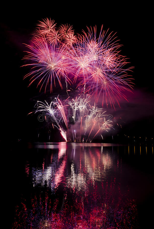 Celebration with fireworks show. Party with colorful fireworks show over the lake royalty free stock photography