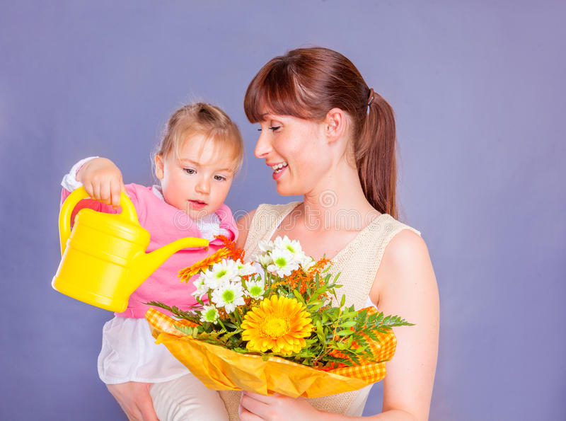 Celebration with flowers. Mothers day fathers day flower gift stock images