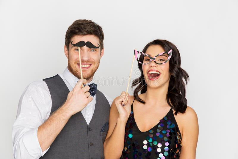 Happy couple with party props having fun. Celebration, fun and holidays concept - happy couple posing with party props royalty free stock photos