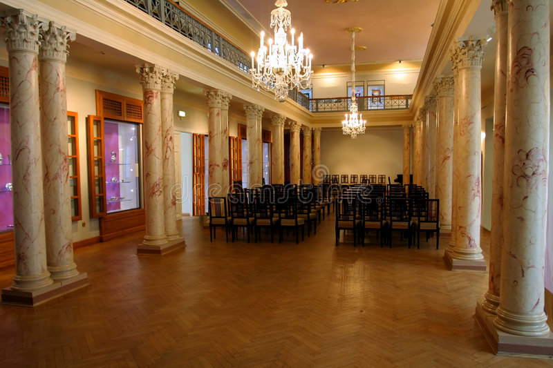 Celebration hall. With marmoreal columns and chandelier royalty free stock photography