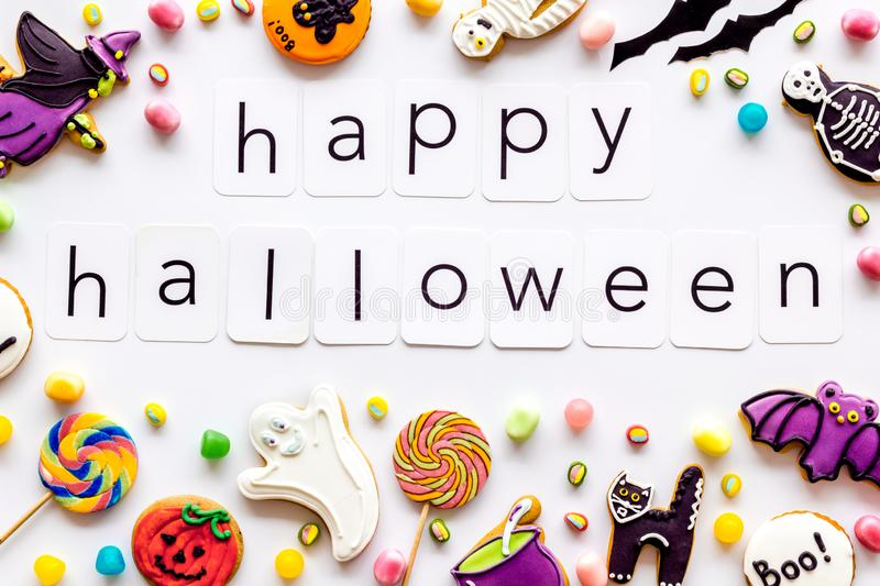 Creepy cookies for halloween treat frame around happy halloween text on white background top view. Celebration halloween and party decorations. Creepy cookies stock image