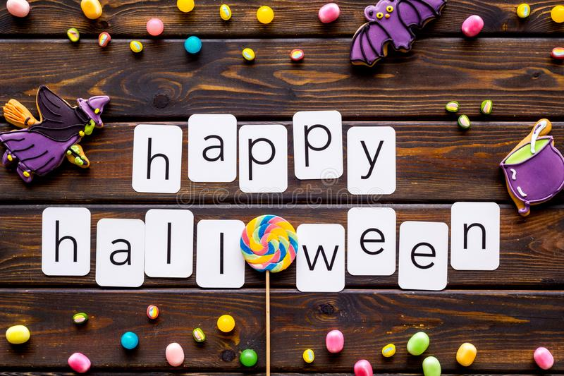 Creepy cookies for halloween treat frame around happy halloween text on wooden background top view royalty free stock photography