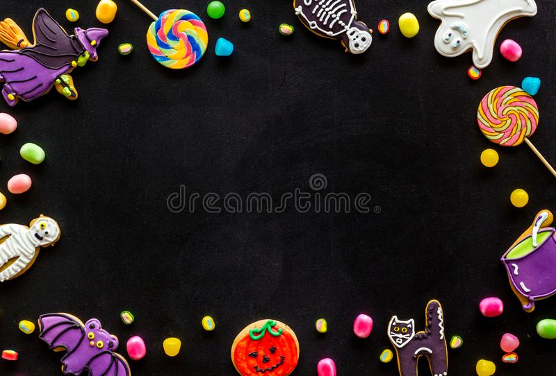 Creepy cookies for halloween treat frame on black background top view mockup. Celebration halloween and party decorations. Creepy cookies for halloween treat royalty free stock photos