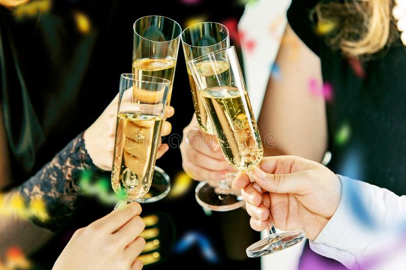 Celebration. Hands holding the glasses of champagne and wine making a toast. The party, alcohol, lifestyle, friendship, holiday, christmas, new, year and stock images
