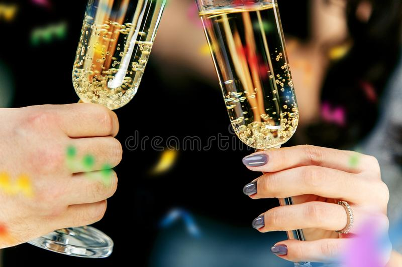 Celebration. Hands holding the glasses of champagne and wine making a toast. The party, celebration, alcohol, lifestyle, friendship, holiday, christmas, new stock photos