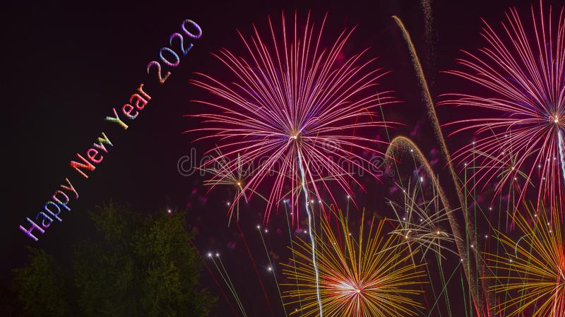 Celebration Happy New Year 2020 with Fireworks background royalty free stock image