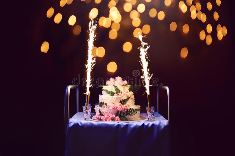 Celebration, holiday birthday cake with candles and fireworks, b stock images