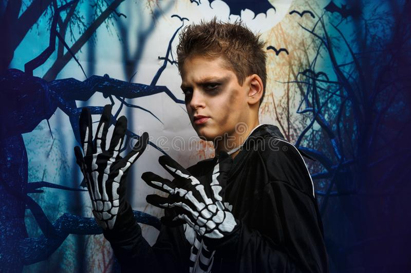 Celebration of holiday Halloween, the cute 8 year boy  in the image, costume, the skeleton theme, the vampire, bat concept. In costume. cosplay stock image