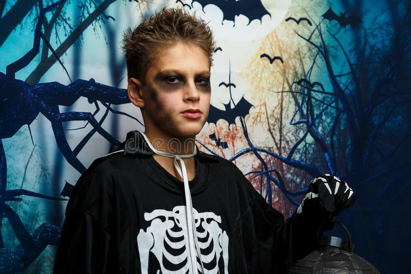 Celebration of holiday Halloween, the cute 8 year boy  in the image, costume, the skeleton theme, the vampire, bat concept. In costume. cosplay royalty free stock image
