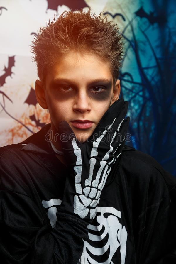 Celebration of holiday Halloween, the cute 8 year boy  in the image, costume, the skeleton theme, the vampire, bat concept. In costume. cosplay royalty free stock photography