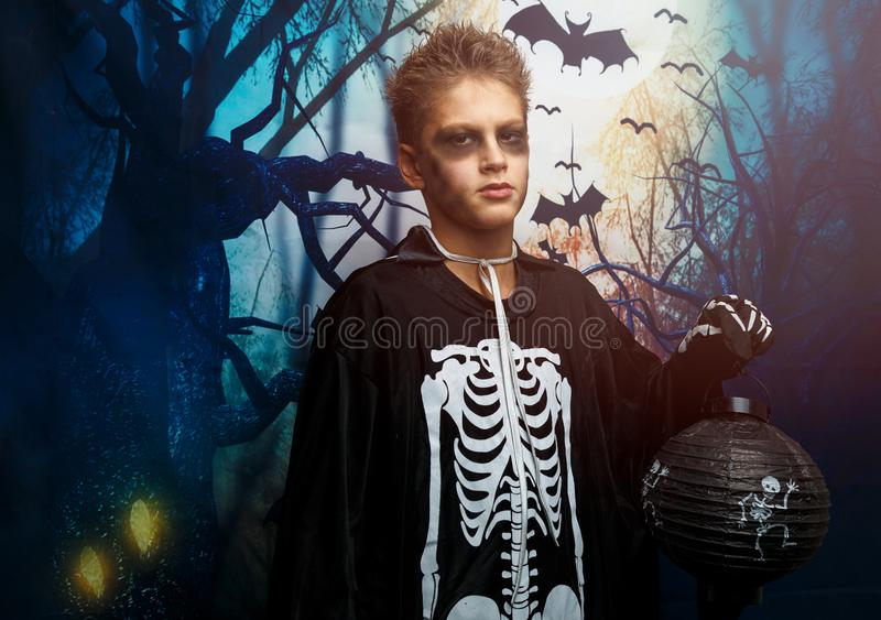 Celebration of holiday Halloween, the cute 8 year boy  in the image, costume, the skeleton theme, the vampire, bat concept. In costume. cosplay stock photos