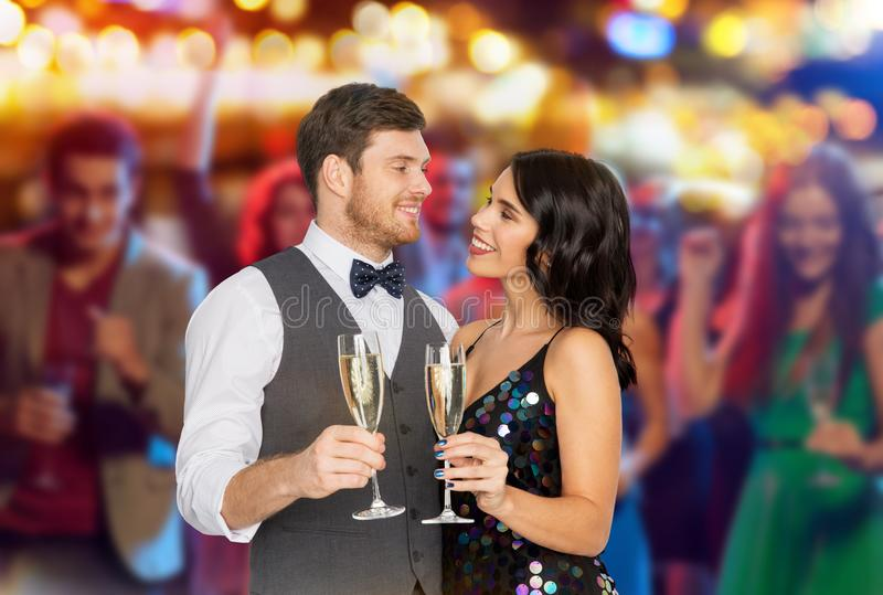 Happy couple with champagne glasses at party royalty free stock images