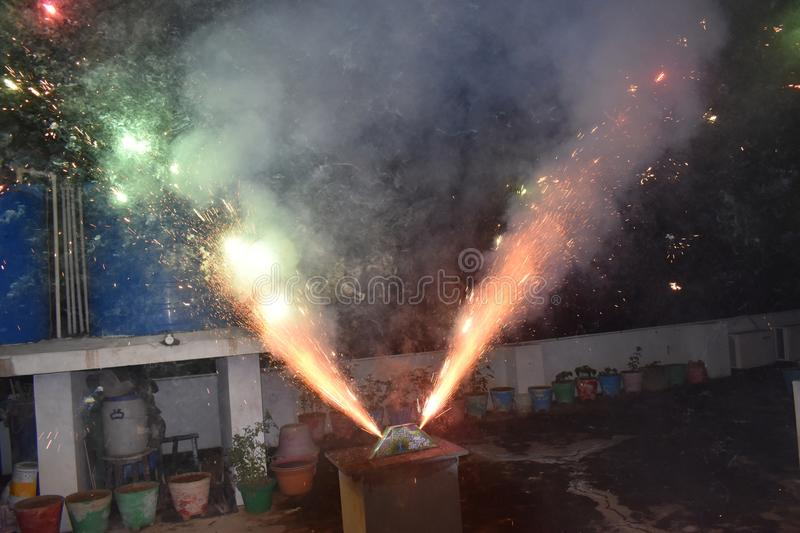 Celebration with illustration of exploding Firecracker A view of a type of firework, cracker named peacock cracker, during the stock photo