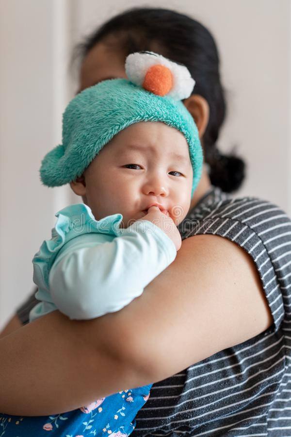 Celebration of life: cute Asian with facial expression while being carried.  stock image