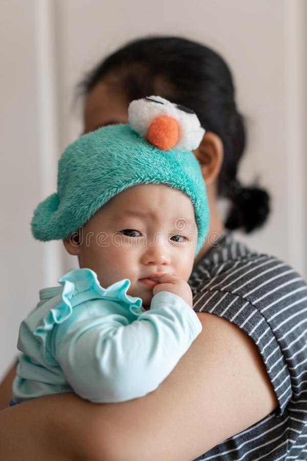 Celebration of life: cute Asian with facial expression while being carried.  royalty free stock photos