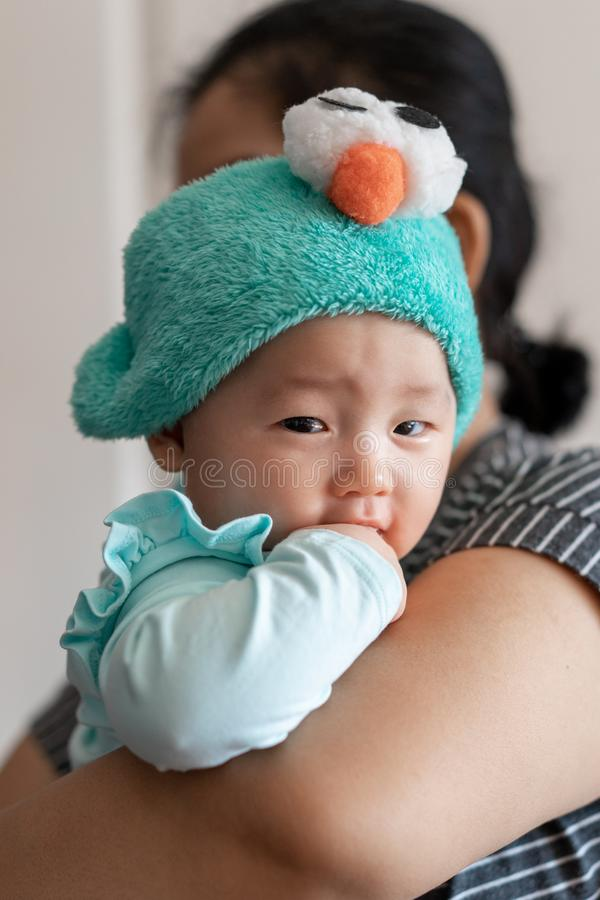 Celebration of life: cute Asian with facial expression while being carried.  stock photo